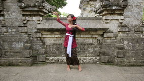 Balinese girl dancing traditional dance in uluwatu temple, bali stock video footage