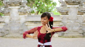 Balinese girl dancing traditional dance in uluwatu temple, bali Stock Photo