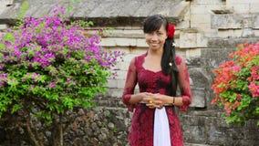 Balinese girl saluting with both hand in uluwatu temple, bali stock footage