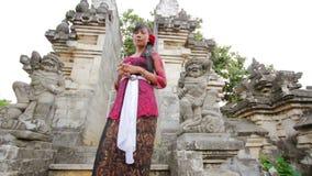 Balinese girl saluting with both hand in uluwatu temple, bali stock video footage
