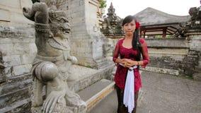Balinese girl saluting with both hand in uluwatu temple, bali stock video
