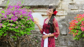 Balinese girl in uluwatu temple, bali, indonesia stock video footage