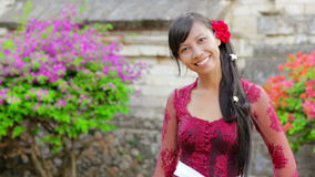 Balinese girl in uluwatu temple, bali, indonesia stock video