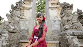 Balinese girl in uluwatu temple, bali, indonesia stock footage