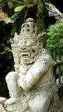 Balinese god (stone) Stock Image