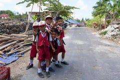 Balinese hindu boys in school uniform Royalty Free Stock Photography