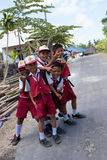 Balinese hindu boys in school uniform Stock Photos