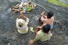 Balinese Hindu devotees pray at sunset. Stock Image