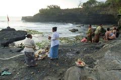 Balinese Hindu devotees pray at sunset. Royalty Free Stock Image