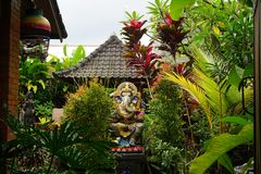 Balinese Hindu elephant statue with plants in Bali Indonesia stock images