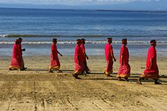 Balinese Hindu men on the beach Stock Photo