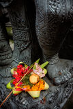 Balinese-Hindu offerings are left for the Gods at a stone-carver's workshop in Ubud, Bali, Indonesia Royalty Free Stock Photos