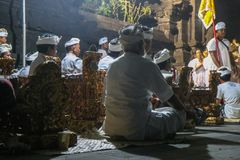 Balinese Hindu priests and people at a ritual at temple, ceremony with music instruments royalty free stock photos