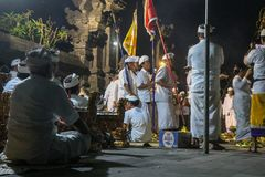 Balinese Hindu priests and people at a ritual at temple, ceremony. With music instruments royalty free stock images