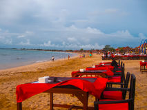 Balinese Jimbaran beach famous for it's perfect sea food restaurants Royalty Free Stock Images