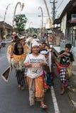 Balinese kids playing Barong walking on the streets of Ubud in Bali, Indonesia. Stock Photo