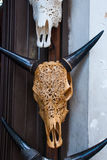 Balinese market. Souvenir cow`s Head made of wood. Bali, Indonesia. Balinese market. Souvenirs of wood and crafts of local residents. Bali, Indonesia Stock Photos