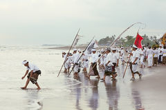 Balinese men during the annual ceremony of purification Melasti Royalty Free Stock Photos