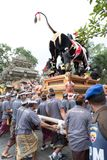 Balinese men carry the black bull sarcophagus during a procession for `Ngaben`, a cremation ceremony at Ubud, Bali, 2nd March 2018. Balinese men carry the black Stock Photo