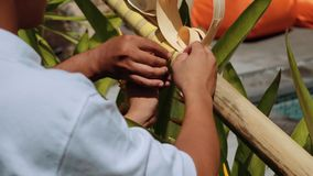Balinese men decorating a penjor on Galungan Day stock video