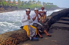 Balinese men by the sea Stock Photo