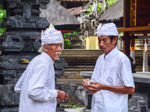 Balinese men at the Tanah Lot temple in Bali, Indonesia Royalty Free Stock Photos