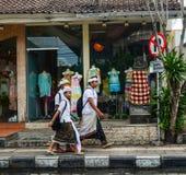 Balinese men walking on street at Ubud village in Bali, Indonesia Royalty Free Stock Image