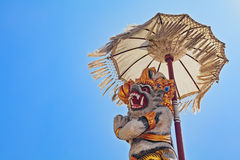 Balinese monkey Hanuman under ceremonial umbrella Stock Images