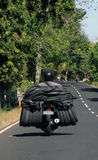 Balinese Motorcyclist carrying an abnormal load Royalty Free Stock Image