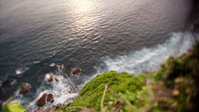 Balinese coast. Balinese ocean coast high top view sea waves and green hill shoting on tilt-shift lens stock footage