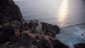 Balinese coast. Balinese ocean coast high top view sea waves and rock shoting on tilt-shift lens stock video footage