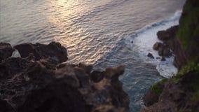 Balinese coast. Balinese ocean coast high top view sea waves and rock shoting on tilt-shift lens stock footage