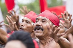 Balinese old man participates in a street ceremony, during a pre-election rally, the Indonesian Democratic Party of Struggle in Gi. GIANYAR, BALI, INDONESIA Royalty Free Stock Images