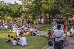 Balinese people around Tanah Lot temple Royalty Free Stock Image
