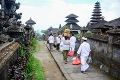 Balinese people walk in traditional dress in Pura Besakih Royalty Free Stock Photos