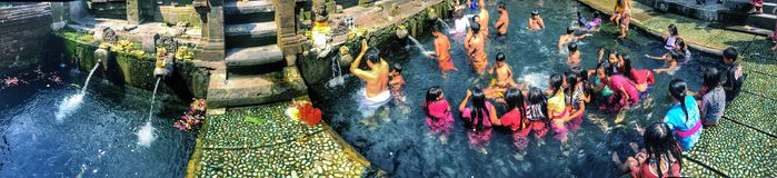 Balinese people at water temple, Bali Stock Image