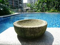 Balinese pot with pool background Royalty Free Stock Photo