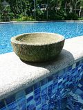 Balinese pot by the pool Royalty Free Stock Images