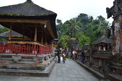 Balinese Prayers in Tirta Empul Temple Bali Stock Photo