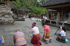 Balinese Prayers in Tirta Empul Temple Bali Stock Image