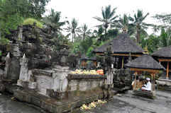 Balinese priest officiating at tampaksiring temple. Near  ubud bali Royalty Free Stock Image