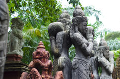 Balinese religious statues in a sacred park. Beauty craved of stone Royalty Free Stock Photo