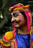 Balinese-Schutz mit gemaltem Gesicht und im traditionellen Kostüm stockbild