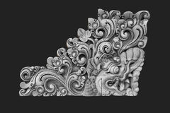 Balinese Sculpture. Isolated on dark background Royalty Free Stock Photography