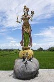 Balinese statue. Statue of Rice Goddess Dewi Sri Royalty Free Stock Photos