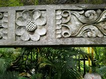 Balinese stone carved garden ornament stock photography
