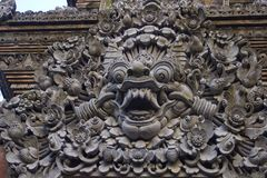 Balinese stone sculpure. Royal Palace decoration. Balinese stone sculpure. Ubud Royal Palace decoration stock image