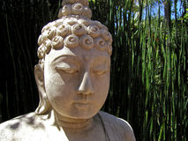 Balinese stone statue. Balinese carved statue in garden Stock Image