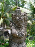 Balinese stone statue. A stone statue of a devil in Bali Stock Photography