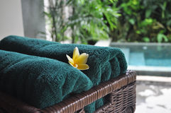 Balinese Style Hotel Towel. Frangipani flower can be found as little detail in most hotel or resort interior in Bali Royalty Free Stock Image